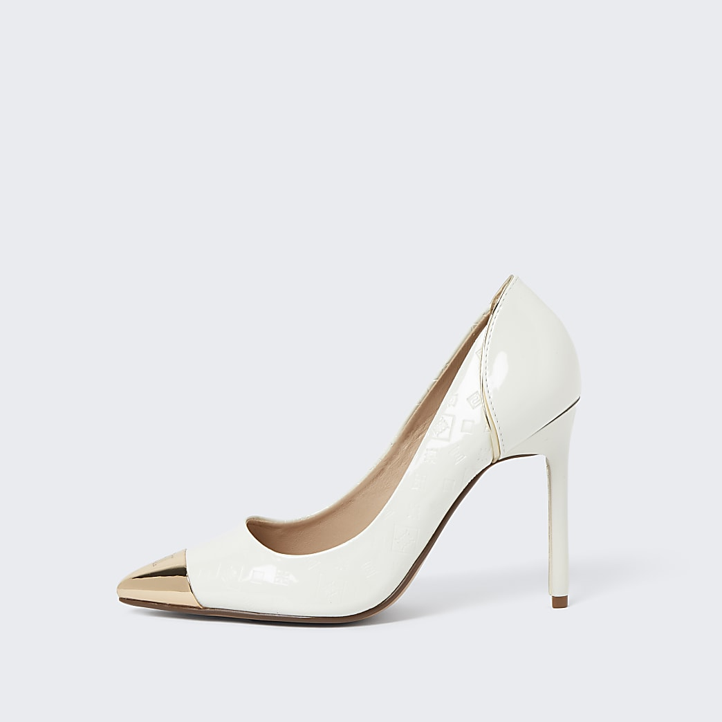 White toe cap court shoes
