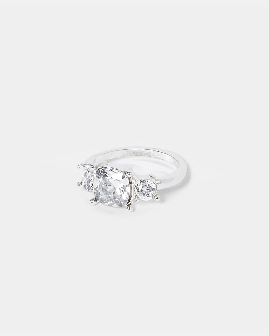White Triple Stone Engagement Ring