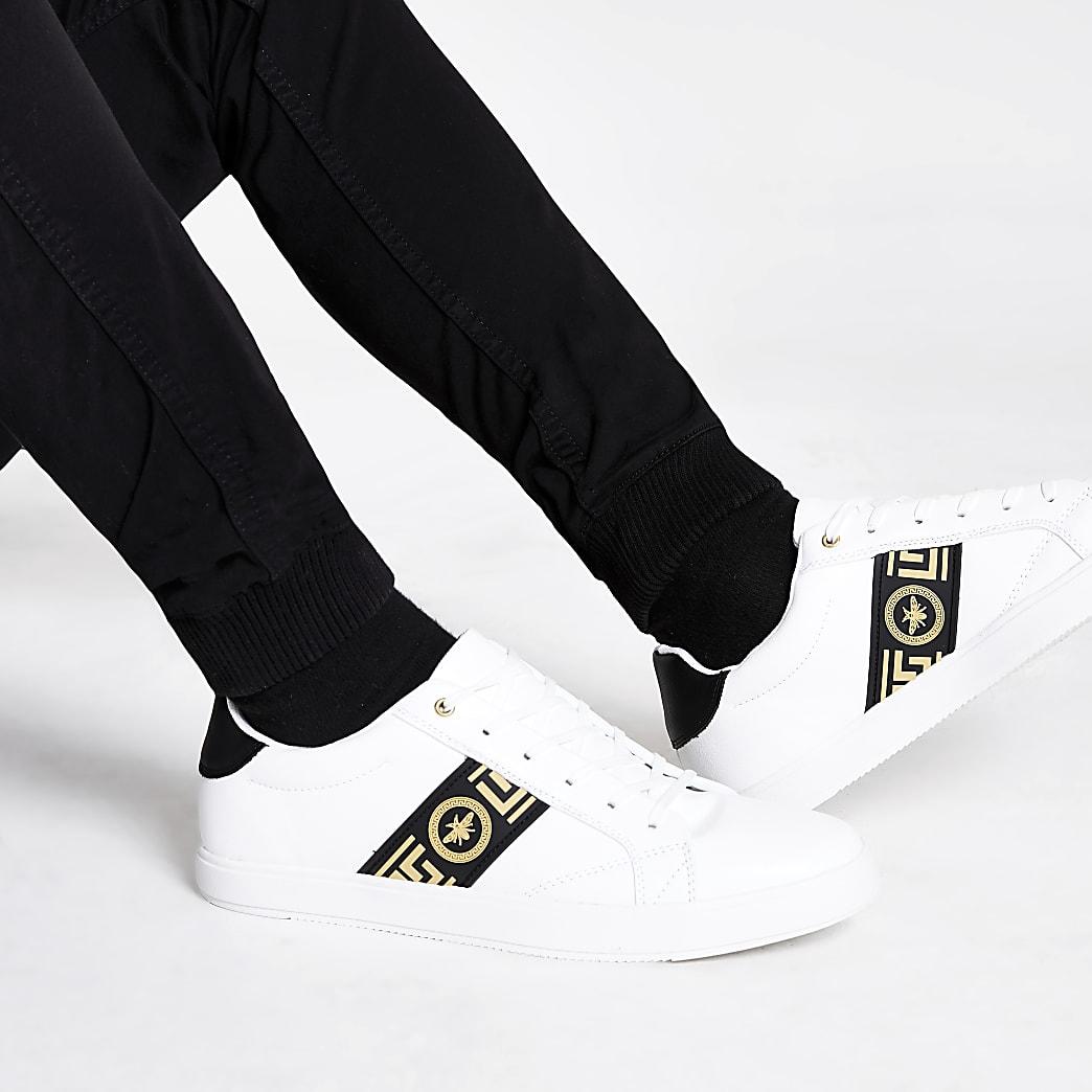 Witte sneakers met wespenprint en vetersluiting