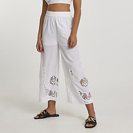 White wide crochet trim trousers
