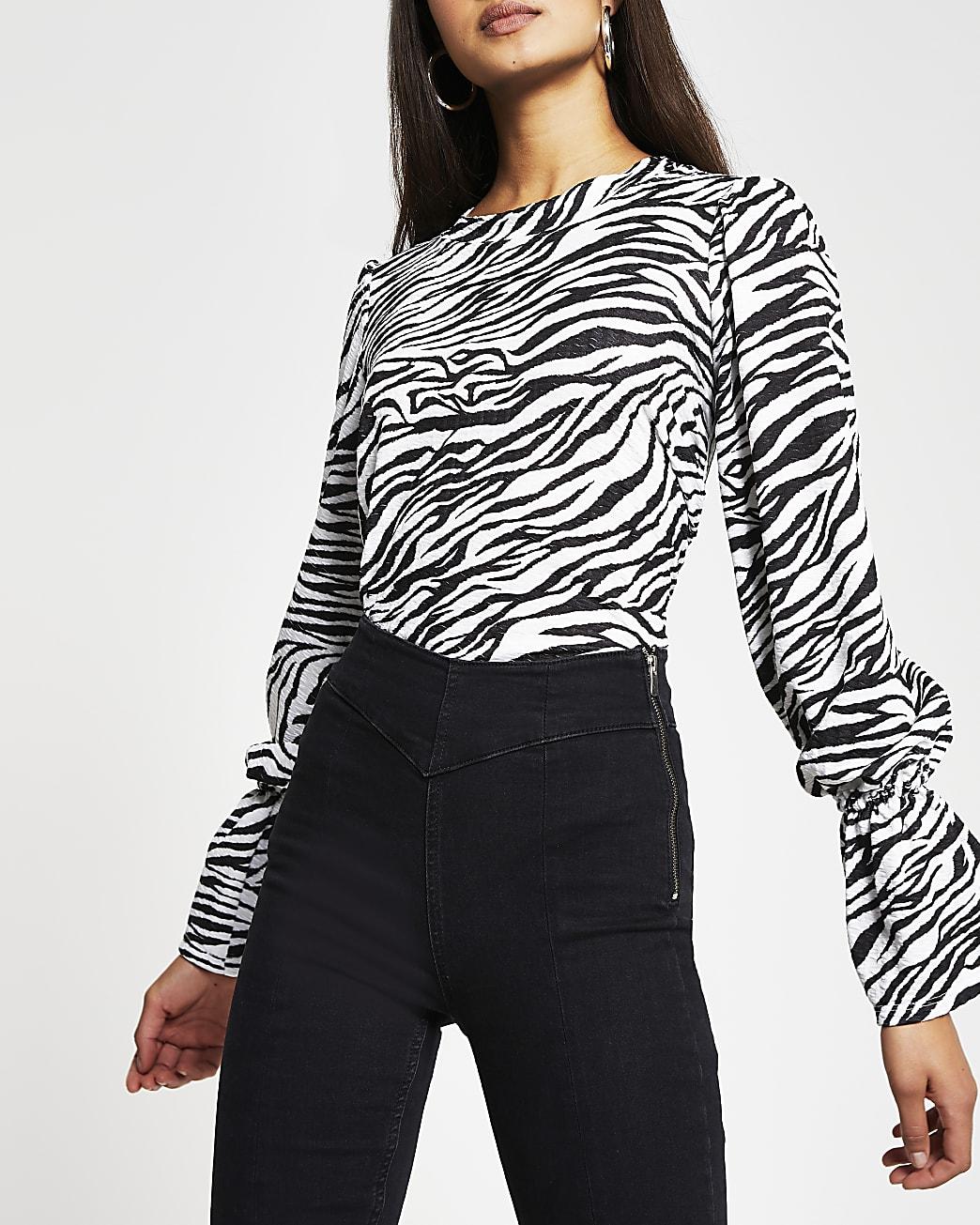 White zebra print puff sleeve crew neck top
