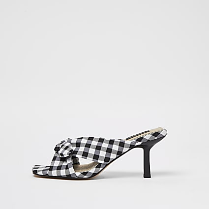 Wide black check cross over bow mules