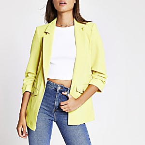 Gele blazer met zakken aan voorzijde met details