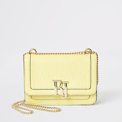 Yellow RI embossed underarm satchel bag