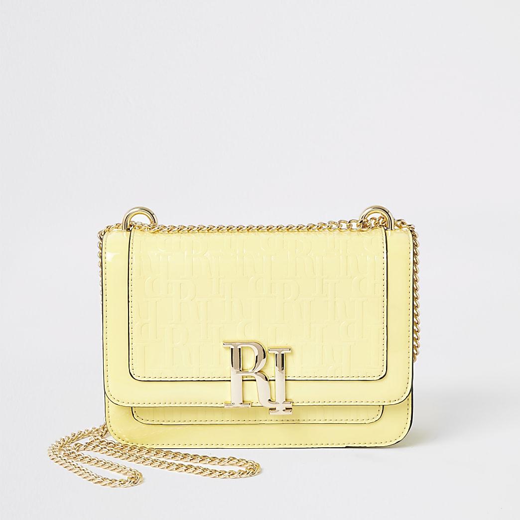Yellow RI embossed underarm satchel bag