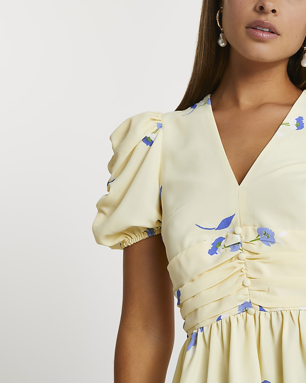 Yellow short puff sleeve ruched tea top