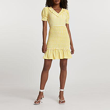 Yellow short sleeve gingham shirred dress