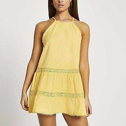 Yellow tiered halter mini swing beach dress